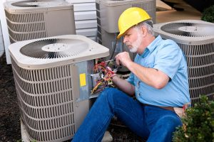 technician working on air conditioning unit