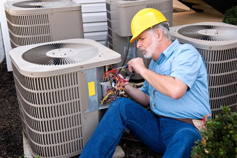 technician-working-on-air-conditioning-unit