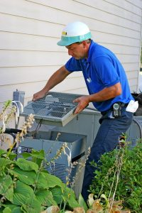 technician taking apart ac to service