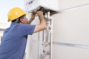 boiler-technician-working-on-gas-system
