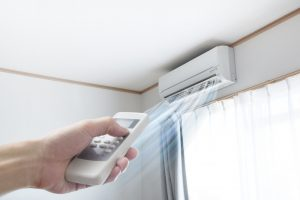 hand-turning-on-ductless-air-handler