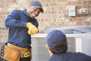 two-techs-working-on-outdoor-ac-unit